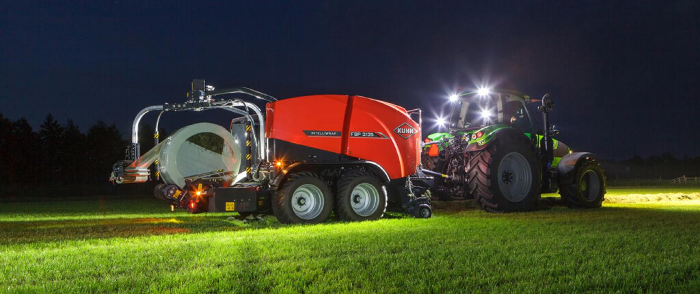 FBP 3135 3D wrapping a bale in the dark lightened with working lights