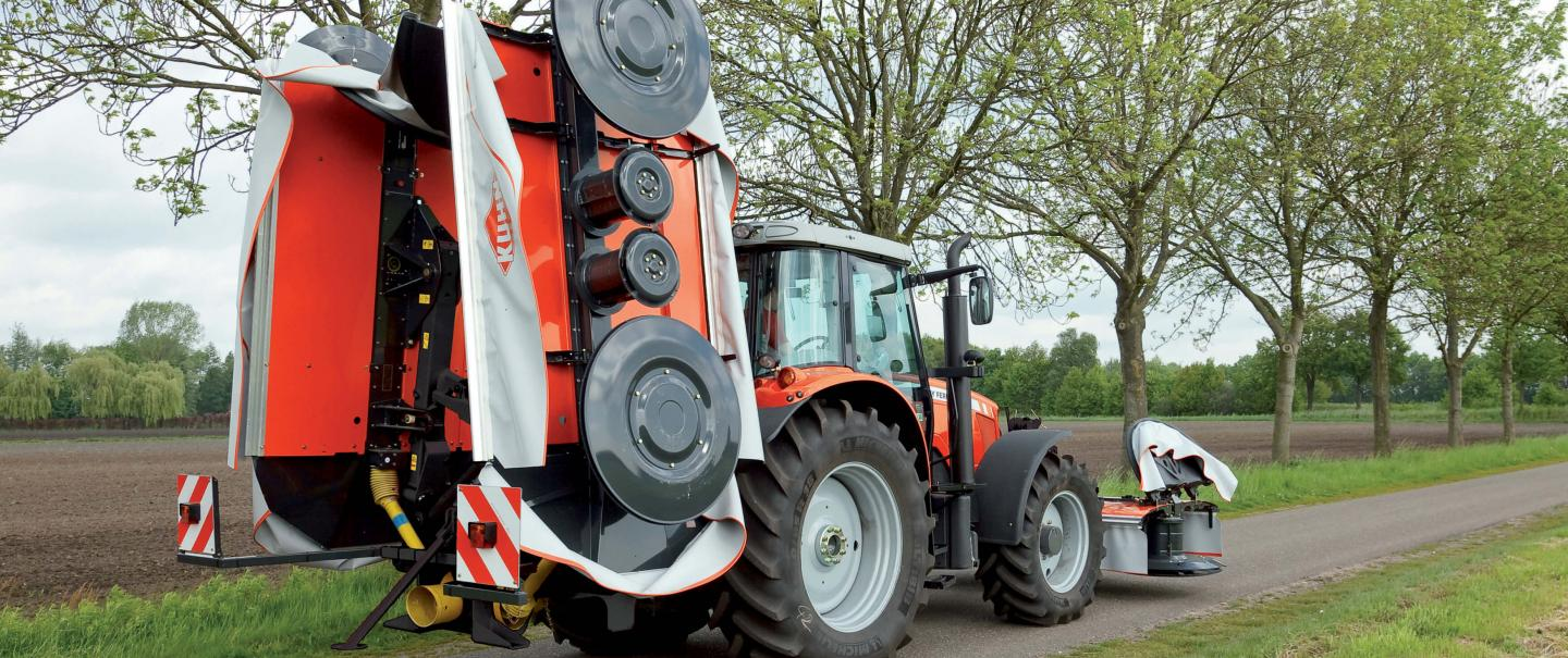 PZ 960 triple drum mower in road transport on a country road
