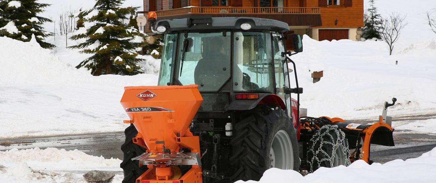 VSA salt and sand spreader at work on mountain roads in the snow